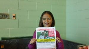 Sarah Holding Sarah's Food Drive flyer